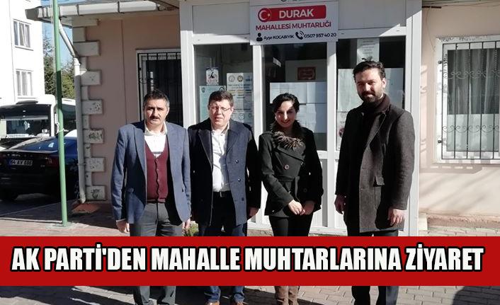AK PARTİ'DEN MAHALLE MUHTARLARINA ZİYARET