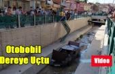 UŞAK'TA DOKUZSELE DERESİNE OTOMOBİLİN UÇMA ANI GÜVENLİK KAMERASINA YANSIDI