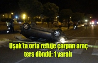 Uşak'ta orta refüje çarpan araç tersdöndü:...