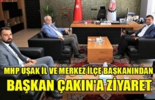 MHP UŞAK İL VE MERKEZ İLÇE BAŞKANINDAN BAŞKAN...